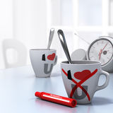 Leaving Relationship Concept, Couple Divorce. Two mugs with I Love U and a red cross on the one at the foreground, conceptual 3D render for leaving a Stock Image