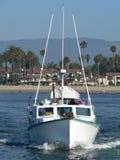 Leaving Santa Barbara. A head on shot of a fishing boat leaving the Santa Barbara marina royalty free stock image