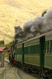 Leaving The Station. A Passenger Steam Train Leaves The Station Stock Image