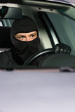 Leaving with stolen vehicle Stock Photo