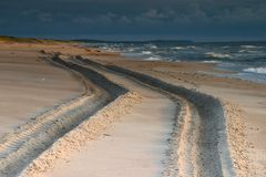 Leaving Tracks. A large vehicle's tracks in the sand.  Neringa, Lithuania Stock Photo