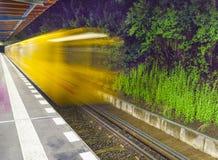 Leaving train at a platform Royalty Free Stock Photo