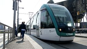 Leaving tram stop, with people waiting on the platform, Barcelona. Spain stock video footage