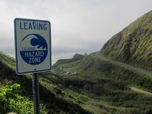 Leaving Tsunami Hazard Zone. A sign posted above the tsunami hazard zone on the Pacific Coast, central Oregon stock image