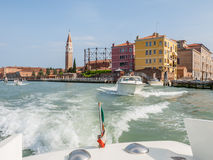 Leaving Venice in a water taxi Stock Images