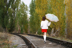 Leaving woman. Young woman in white leaving on the railway Royalty Free Stock Photography