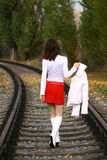 Leaving woman. Young woman in white leaving on the railway Royalty Free Stock Photo