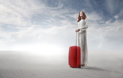 Leaving Woman. Woman in white standing with her red trolley in a desert Royalty Free Stock Images