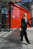 Leaving Work. A beautiful young business woman leaving work at a hi tech office building royalty free stock images