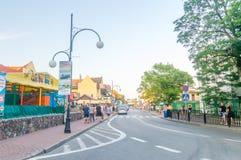 Street with tourists in Leba. Leba is resort on Baltic sea. Stock Photography