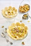 Lebanese Ashta milk pudding with pistachio, rose water and honey. Lebanese, Middle Eastern, Ashta milk pudding with rose water, pistachio, honey and bananas stock images