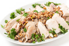 Lebanese chicken and spiced rice with nuts and parsley Stock Photography
