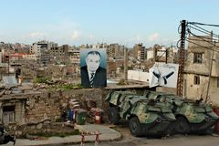 Lebanon, Tripoli; February 13th 2011 - Street in Tripolis city. Lebanese city life with posters of politicians and building at the background. Tanks on the stock photo