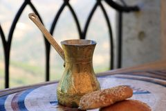 Lebanese Coffee Pot & Sweets. A Lebanese coffee pot made of brass and accompanying traditional sweets called maamoul stock image