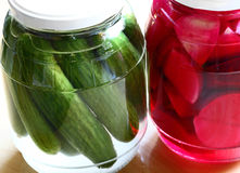 Lebanese Cusine: pickled turnips and cucmbers. Traditional Lebanese pickles with the bright pink color of the turnips coming from the beetroot in the pickling stock photography