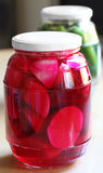 Lebanese Cusine: pickled turnips and cucmbers. Traditional Lebanese pickles with the bright pink color of the turnips coming from the beetroot in the pickling royalty free stock photos
