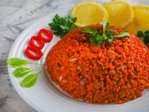 Pilaf with bulgur with tomatoes and onions. Arabic cuisine in Ramadan. Lebanese dish with bulgur, tomatoes and onions on light background Stock Photography