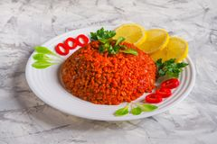 Pilaf with bulgur with tomatoes and onions. Arabic cuisine in Ramadan. Lebanese dish with bulgur, tomatoes and onions on light background Royalty Free Stock Photography
