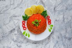 Pilaf with bulgur with tomatoes and onions. Arabic cuisine in Ramadan. Lebanese dish with bulgur, tomatoes and onions on light background Stock Photo