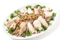 Lebanese dish of chicken and spiced rice with nuts and parsley Stock Photo
