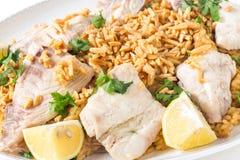 Lebanese fish rice and nuts closeup Stock Photos