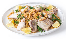 Lebanese fish rice and nuts serving dish Royalty Free Stock Photo