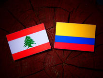Lebanese flag with Colombian flag on a tree stump isolated vector illustration