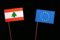 Lebanese flag with European Union EU flag  on black Stock Image