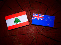 Lebanese flag with New Zealand flag on a tree stump isolated Stock Foto