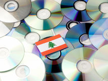 Lebanese flag on top of CD and DVD pile isolated on white. Lebanese flag on top of CD and DVD pile isolated Stock Image