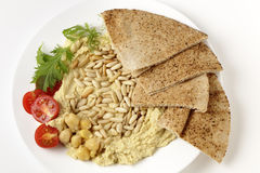 Lebanese hummus and pine nuts from above Royalty Free Stock Images