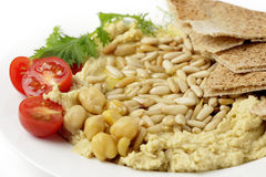 Lebanese hummus and pine nuts withoil Royalty Free Stock Photo