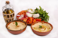 Lebanese hummus plate with olive & vegetables. Lebanese hummus plate with olive and vegetables Stock Photography