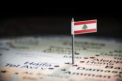 Lebanese marked with a flag on the map.  royalty free stock image