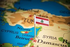 Lebanese marked with a flag on the map.  stock image