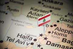 Lebanese marked with a flag on the map.  stock photos