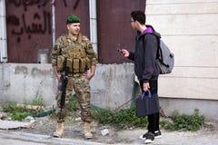 Lebanese soldier patrols Beirut street royalty free stock image