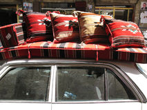 Lebanese Souk Scene. A scene from a Lebanese old souk in the city of Tripoli. A car transporting furniture on its top Royalty Free Stock Photos