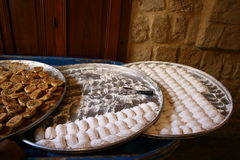 Lebanese sweets in the souk. Home made and sold from big plates royalty free stock photography