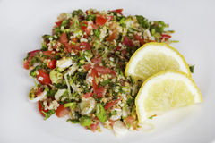 Lebanese Tabbouleh with lemon slices Royalty Free Stock Photo