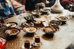 Lebanon cuisine served in restaurant. A young company of people is smoking a hookah and communicating in an oriental restaurant. T. Raditional meze lunch stock photo