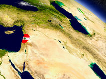 Lebanon with embedded flag on Earth Stock Images