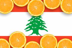 Lebanon flag in citrus fruit slices horizontal frame. Lebanon flag in horizontal frame of orange citrus fruit slices. Concept of growing as well as import and stock illustration