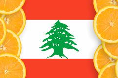 Lebanon flag in citrus fruit slices vertical frame. Lebanon flag in vertical frame of orange citrus fruit slices. Concept of growing as well as import and export stock illustration