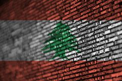 Lebanon flag is depicted on the screen with the program code. The concept of modern technology and site development.  royalty free illustration