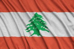 Lebanon flag is depicted on a sports cloth fabric with many folds. Sport team banner. Lebanon flag is depicted on a sports cloth fabric with many folds. Sport royalty free illustration