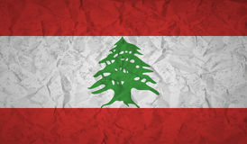 Lebanon flag with the effect of crumpled paper and grunge Royalty Free Stock Photo