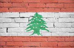 Lebanon flag is painted onto an old brick wall vector illustration