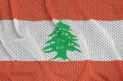 Lebanon flag printed on a polyester nylon sportswear mesh fabric. With some folds vector illustration