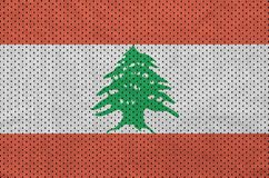 Lebanon flag printed on a polyester nylon sportswear mesh fabric. With some folds royalty free illustration